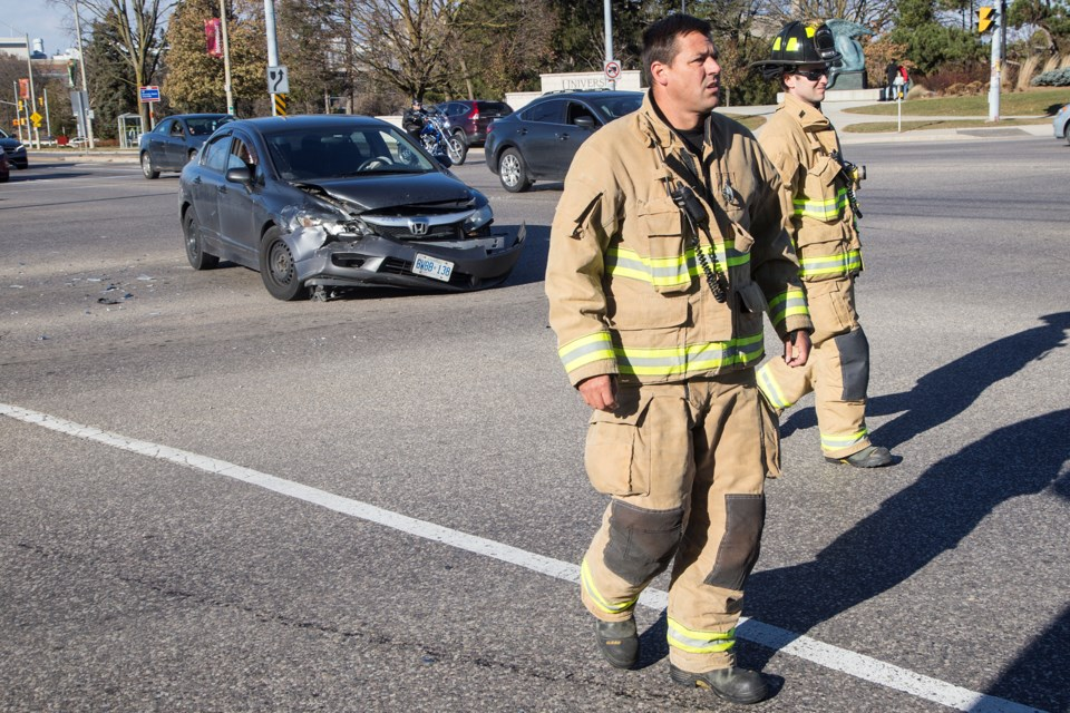 Firefighters on the scene of a collision Tuesday afternoon on Gordon St. at Stone Rd. Kenneth Armstorng/GuelphToday