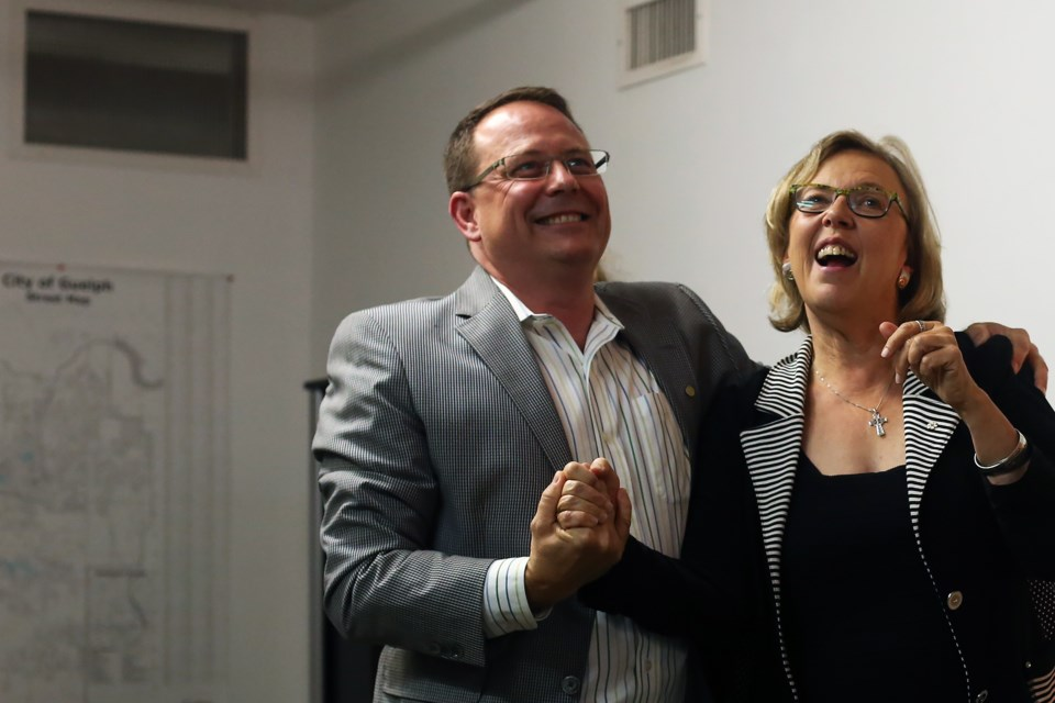 Mike Schreiner, leader of the Green Party of Ontario, embraces Green Party of Canada leader Elizabeth May at the opening of Schreiner's campaign office Tuesday. Kenneth Armstrong/GuelphToday