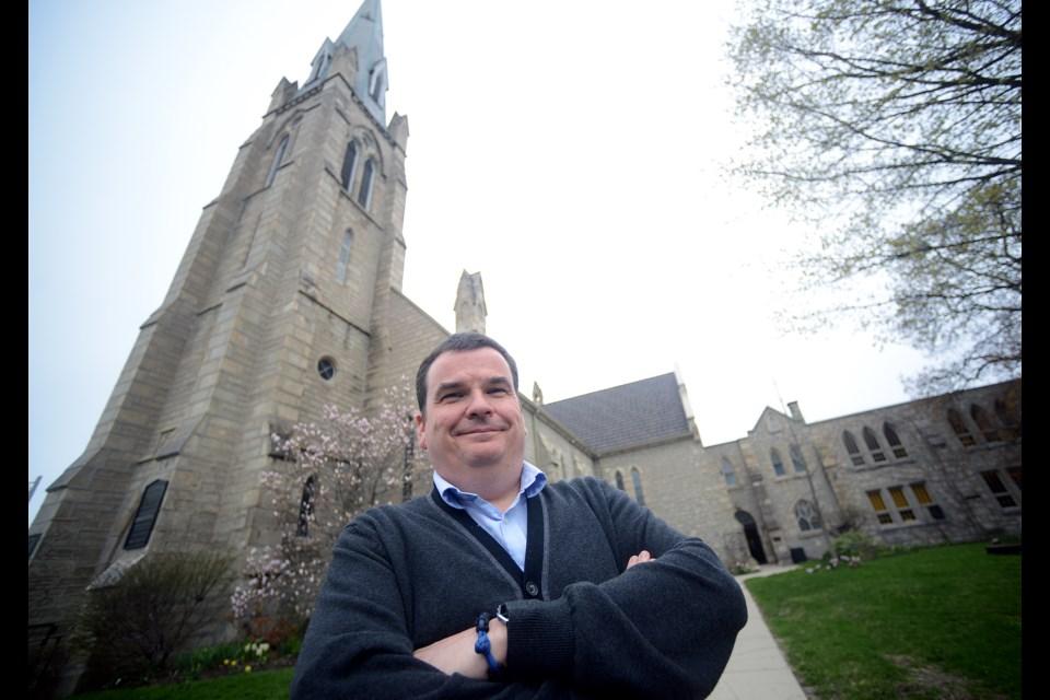 Rev. John Borthwick stands in front of St. Andrew's Presbyterian Church. Tony Saxon/GuelphToday