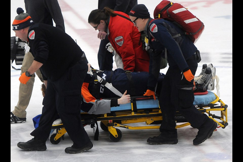 Injured Flint Firebirds player Jack Phibbs gives the thumbs up to the crowd and teammates as he is stretchered off the ice in Flint after colliding with a Guelph Storm player Sunday, Feb. 12, 2017, in Flint. He was reportedly okay. Tony Saxon/GuelphToday