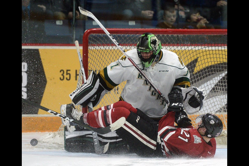 James McEwan of the Guelph Storm slides into London Knights goaltender Tyler Parsons after being tripped on a breakaway Sunday, March 12, 2017, at the Sleeman Centre. Tony Saxon/GuelphToday