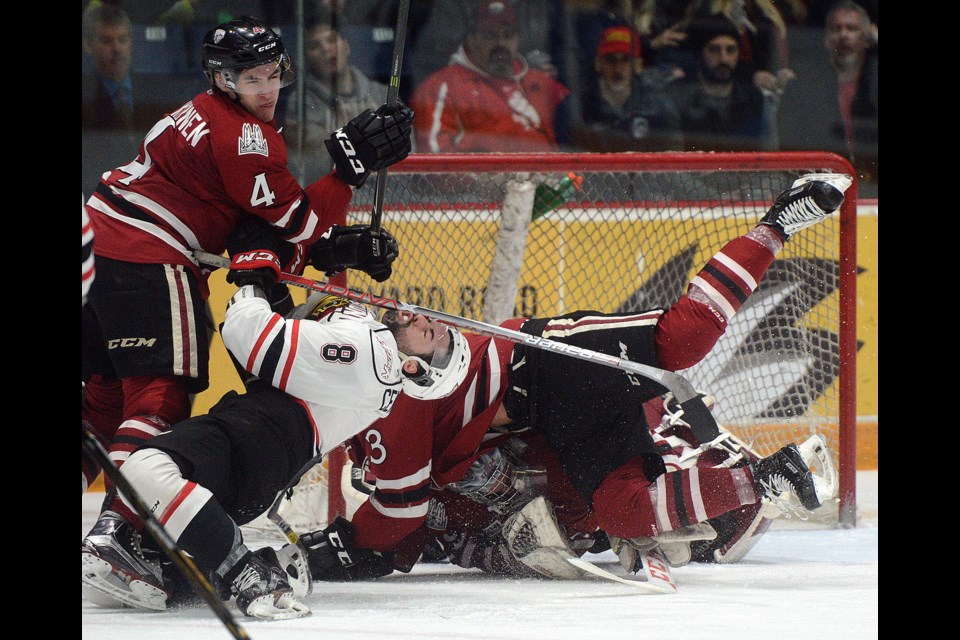 Santino Centorame  is cross checked by the Guelph Storm's Nolan Makkanen after scoring Sunday, March 19, 2017, at the Sleeman Centre. Tony Saxon/GuelphToday