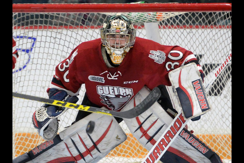 Guelph Storm goaltender Michael Giugovaz watches an incoming point shot in a game against the Saginaw Spirit Friday at the Sleeman Centre. Tony Saxon/GuelphToday