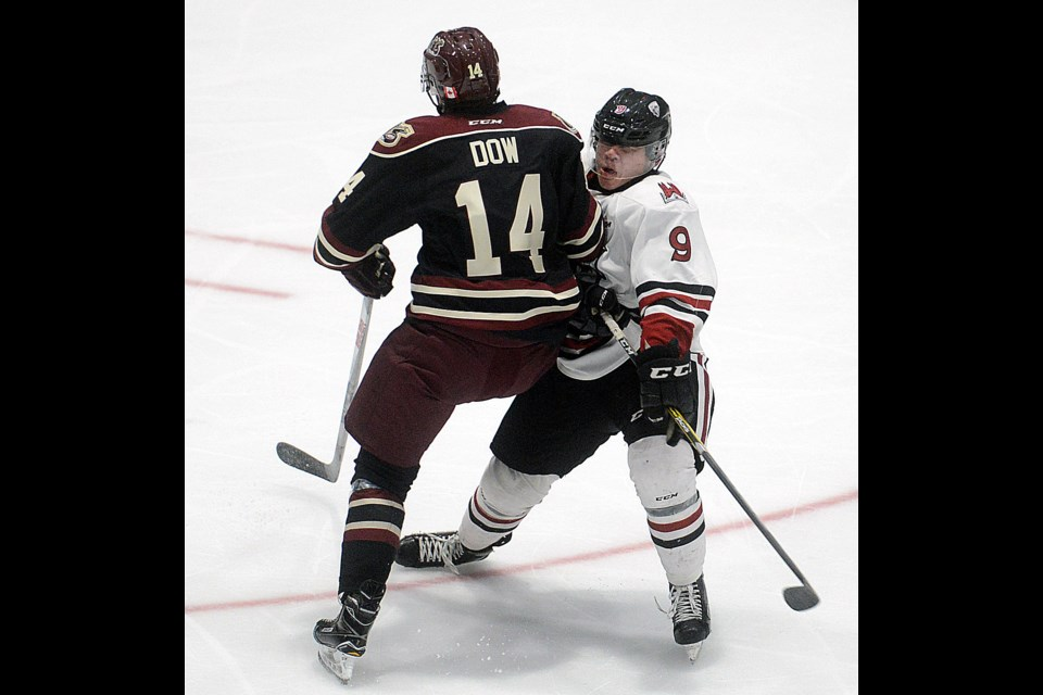 Bobby Dow of the Peterborough Petes was called for a penalty on this hit on the Guelph Storm's Barret Kirwin Saturday, Sept. 16, 2017. Tony Saxon/GuelphToday