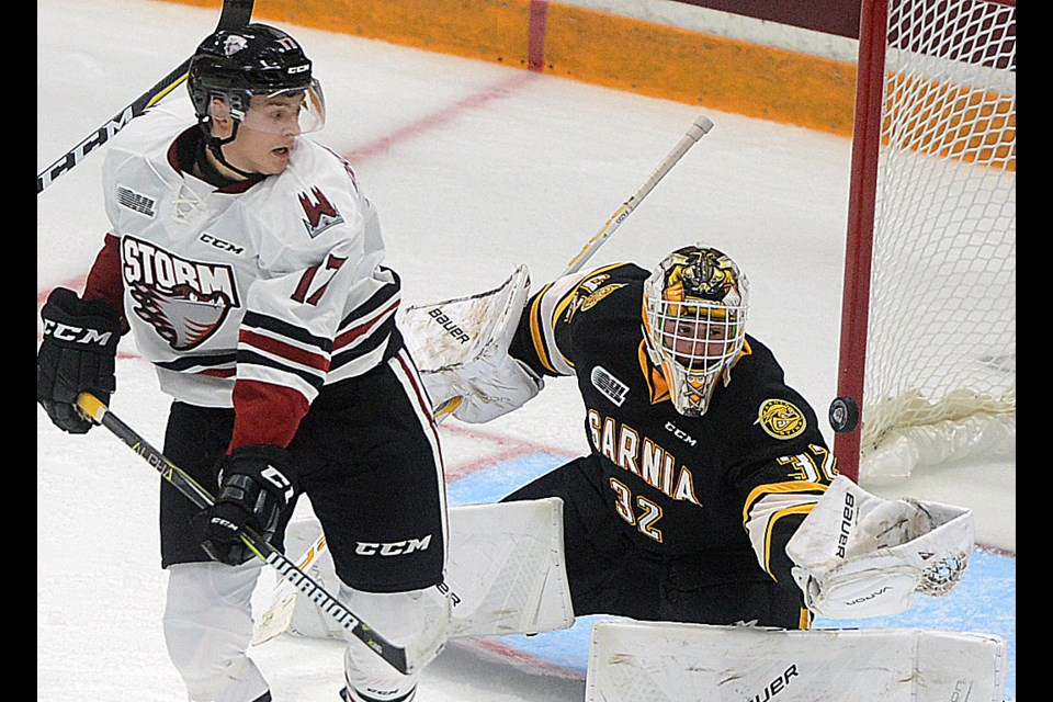 Sarnia Sting goaltender Justin Fazio makes a glove save with the Guelph Storm's Alexey Toropchenko on his doorstep Friday, Sept. 22, 2017, at the Sleeman Centre. Tony Saxon/GuelphToday