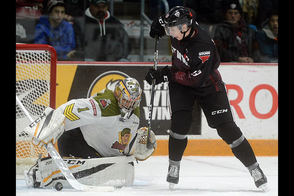 Isaac Ratcliffe of the Guelph Storm tries to tip the puck past North Bay Battalion goaltender Julian Simes Friday, Nov. 10, 2017, at the Sleeman Centre. Tony Saxon/GuelphToday