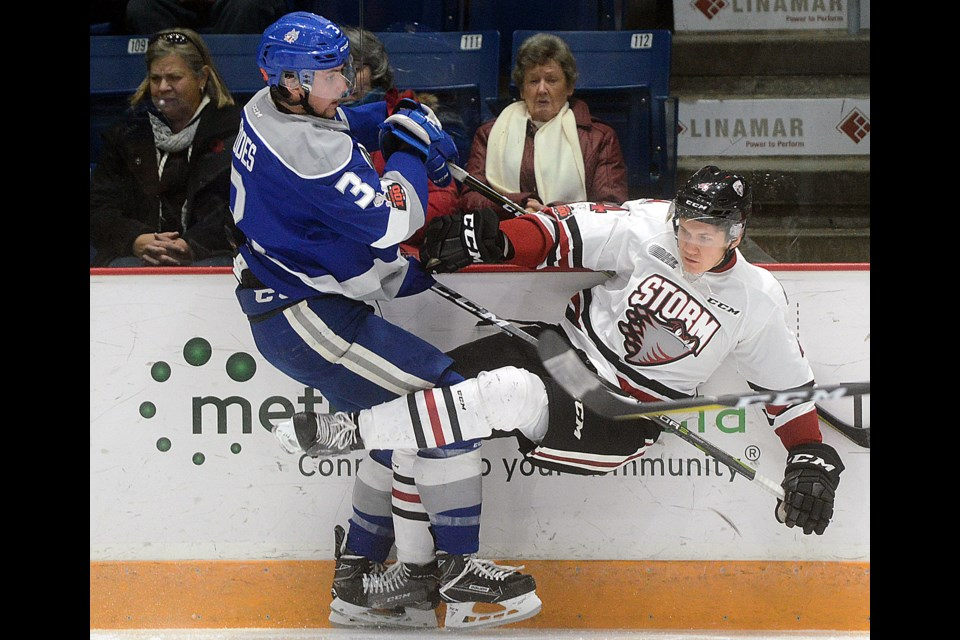 Kyle Rhodes, left, of the Sudbury Wolves knocks down the Guelph Storm's Owen Lalonde Sunday, Nov. 12, 2017, at the Sleeman Centre. Tony Saxon/GuephToday