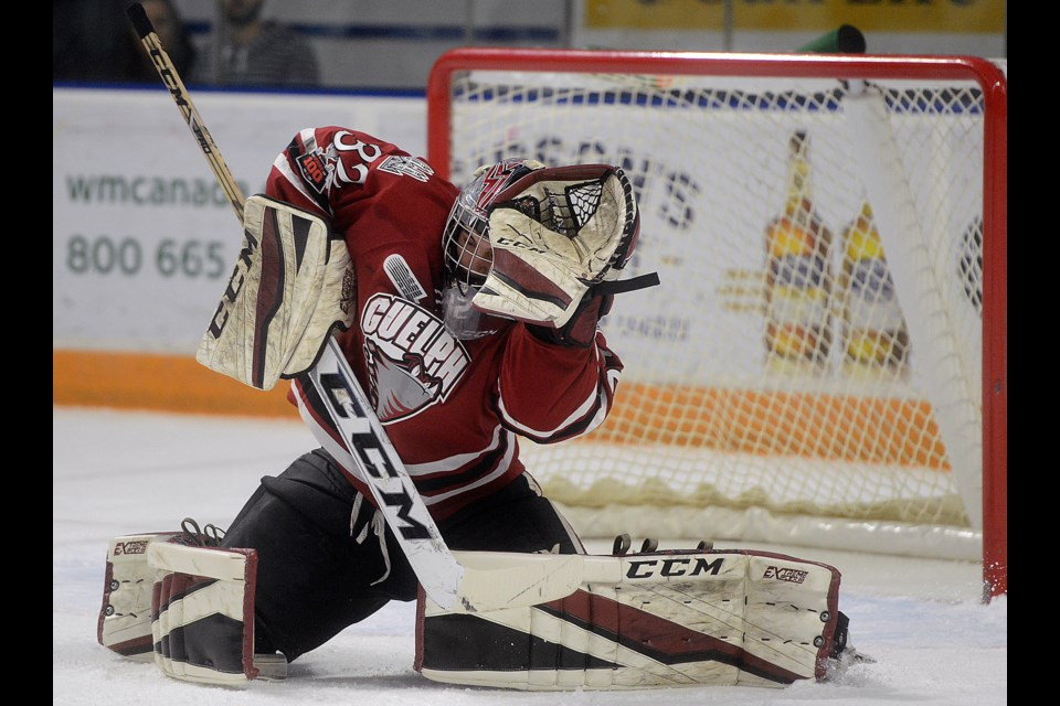 Guelph Storm goaltender Anthony Popovich ducks to avoid a high shot Friday, Nov. 17, 2017, in Kitchener. Tony Saxon/GuelphToday