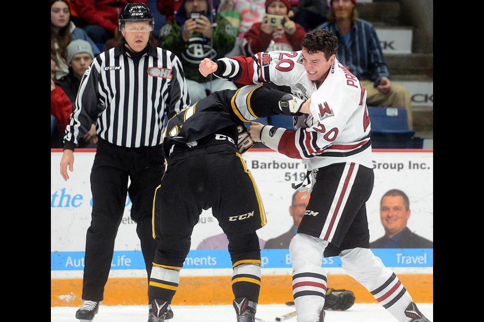 The Guelph Storm's Mason Primeau fights with the Sarnia Sting's Sean Josling Sunday, Nov. 19, 2017, at the Sleeman Centre. Tony Saxon/GuelphToday