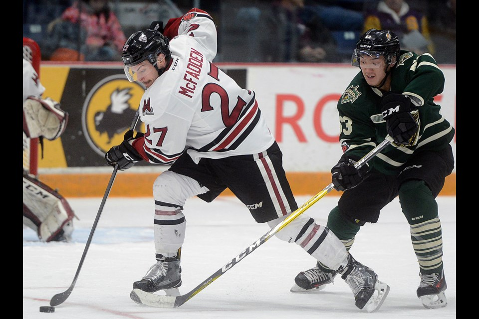 The Guelph Storm's Garrett McFadden is chased by the London Knights' Cluff Pu during action at the Sleeman Centre Sunday, Nov. 26, 2017. Tony Saxon/GuelphToday