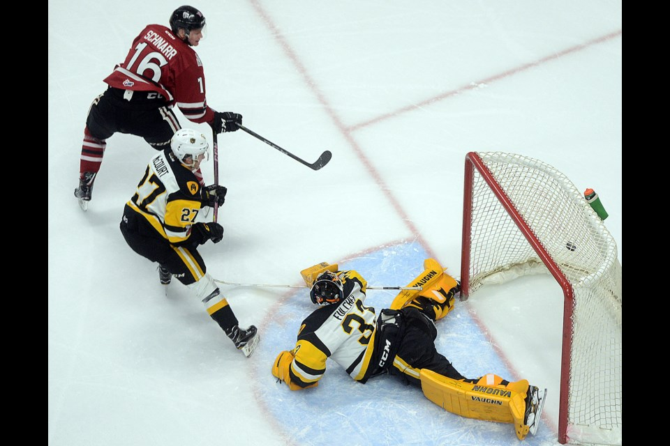 The Guelph Storm's Nate Schnarr scores on a backhand against the Hamilton Bulldogs' Kaden Fulcher to open the scoring Wednesday, Dec. 6, 2017, in Hamilton. Tony Saxon/GuelphToday