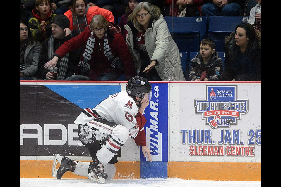 Fans check on the well being of the Guelph Storm's Ryan Merkley after a high stick Friday, Dec. 15, 2017, against the Kingston Frontenacs at the Sleeman Centre. Tony Saxon/GuelphToday