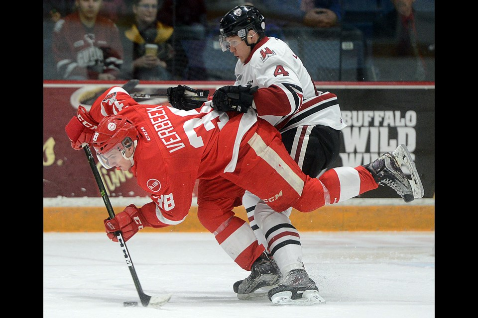 Hayden Verbeek of the Saut Ste. Marie Greyhounds is upended by Owen Lalonde of the Guelph Storm Saturday, Dec. 16, 2017, at the Sleeman Centre. Tony Saxon/GuelphToday