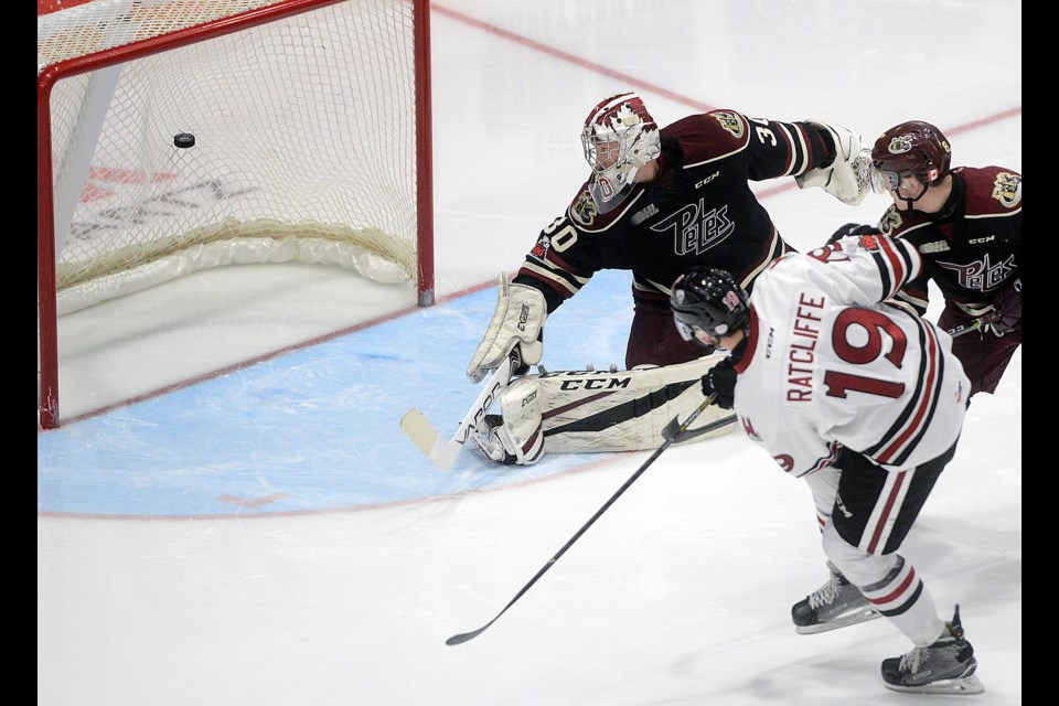 Isaac Ratcliffe of the Guelph Storm fires a rebound past Peterborough Petes goaltender Dylan Wells for his second goal of the game Thursday, Dec. 28, 2017, at the Sleeman Centre. Tony Saxon/GuelphToday