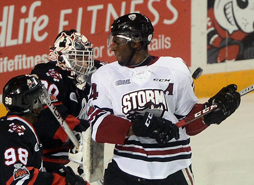 The Guelph Storm's Givani Smith gets hit by a puck in front of the Niagara IceDogs net Thursday, Jan. 4, 2018, in St. Catharines. Tony Saxon/GuelphToday
