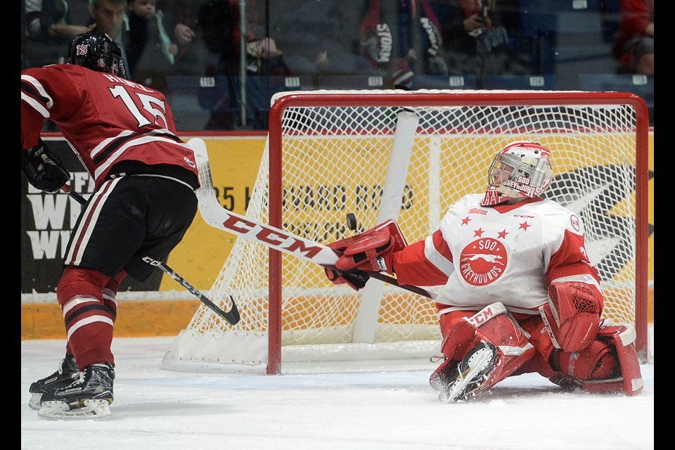 Soo Greyhounds goalender Matthew Villalta makes a save on the Guelph Storm's Liam Hawel Sunday, Jan. 7, 2018, at the Sleeman Centre. Tony Saxon/GuelphToday