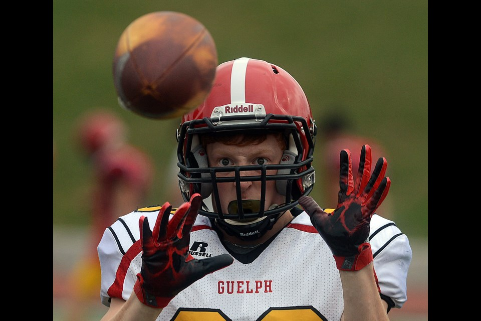 Guelph Gryphon rookie Ben Slinger concentrates on catching a ball during the first day of on-field workouts at training camp Friday, Aug. 11, 2017. Tony Saxon/GuelphToday