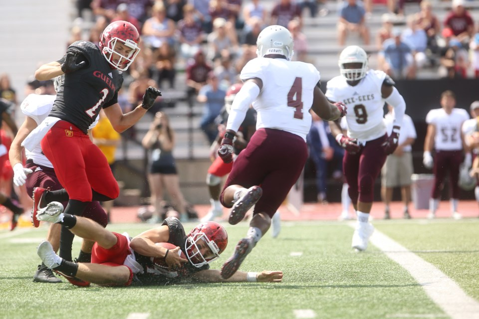 Gryphons quarterback James Roberts seen sliding to gain yardage during a game against the visiting Ottawa Gee-Gees on Sunday. Kenneth Armstrong/GuelphToday