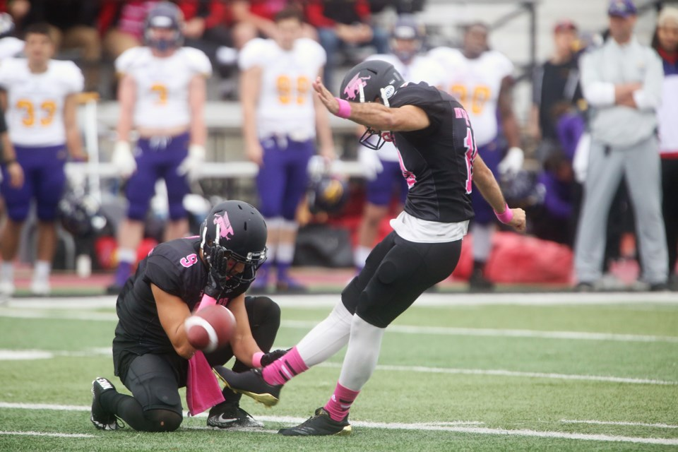 Gryphons kicker Gabriel Ferraro makes a field goal attempt during Saturday's game against the Wilfred Laurier Golden Hawks at Alumni Stadium in Guelph. Kenneth Armstrong/GuelphToday
