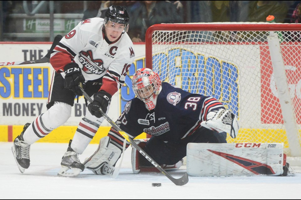 Isaac Ratcliffe grabs the puck in front of Oshawa goalie Kyle Keyser. Tony Saxon/GuelphToday