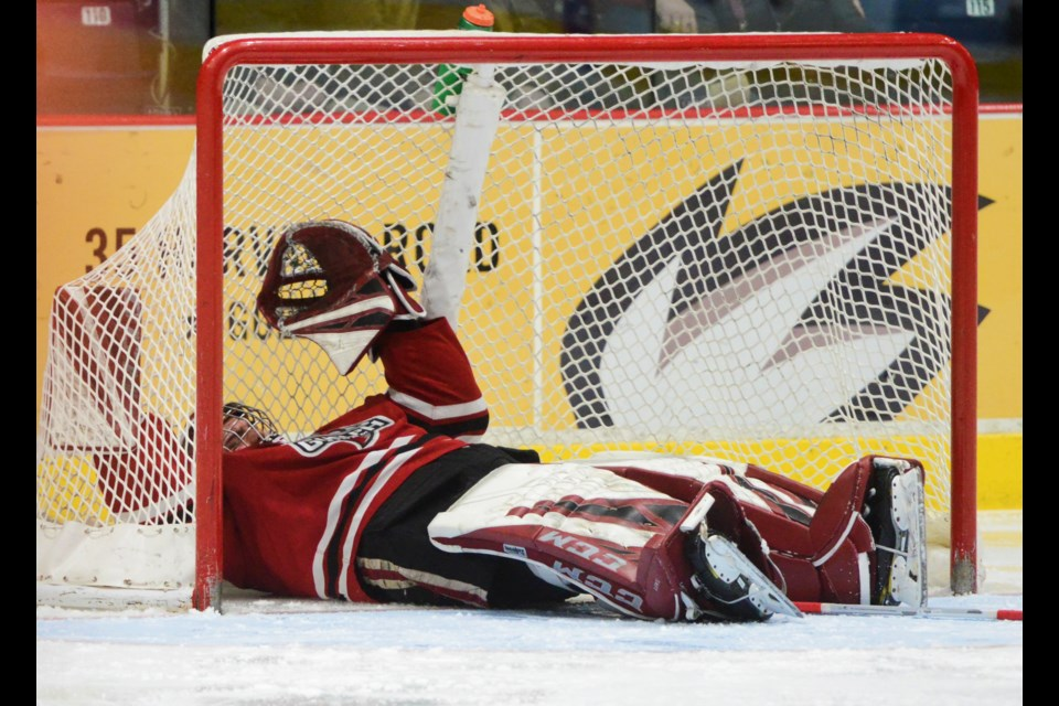Guelph Storm goaltender Nico Daws lies on his back after being bumped into the net Monday at the Sleeman Centre. Tony Saxon/GuelphToday