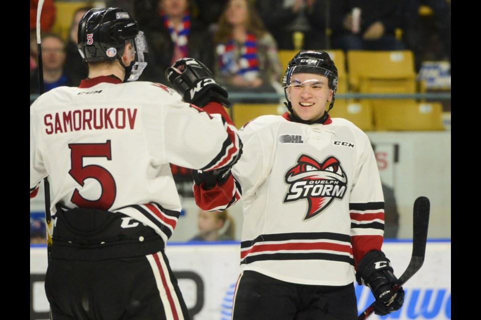 Nick Suzuki celebrates his goal with teammate Dmitri Samorukov at The Aud in Kitchener on Sunday. Tony Saxon/GuelphToday