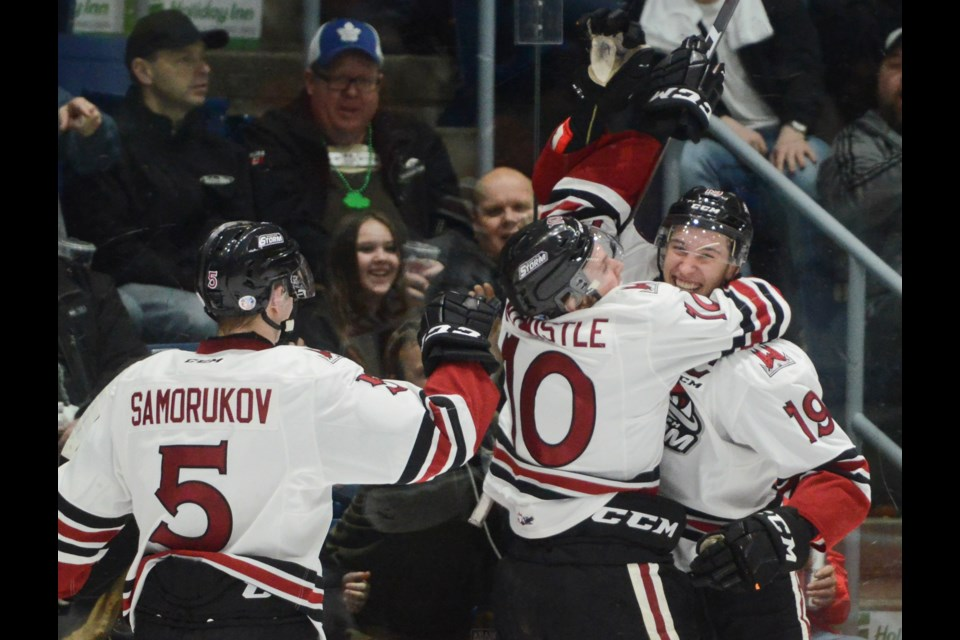 Isaac Ratcliffe, right, is congratulated by teammates MacKenzie Entwistle and Dmitri Samorukov after scoring his 50th goal of the season Friday at the Sleeman Centre. Tony Saxon/GuelphToday