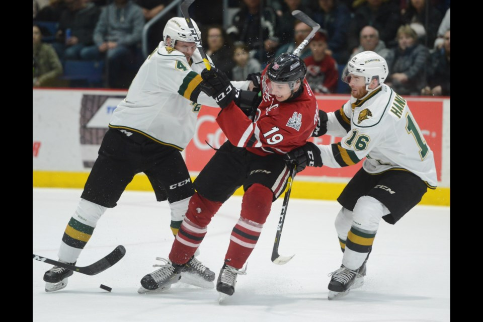 Isaac Ratcliffe of the Guelph Storm is sandwiched between London Knights Will Lochead, left, and Kevin Hancock Monday at the Sleeman Centre. Tony Saxon/GuelphToday