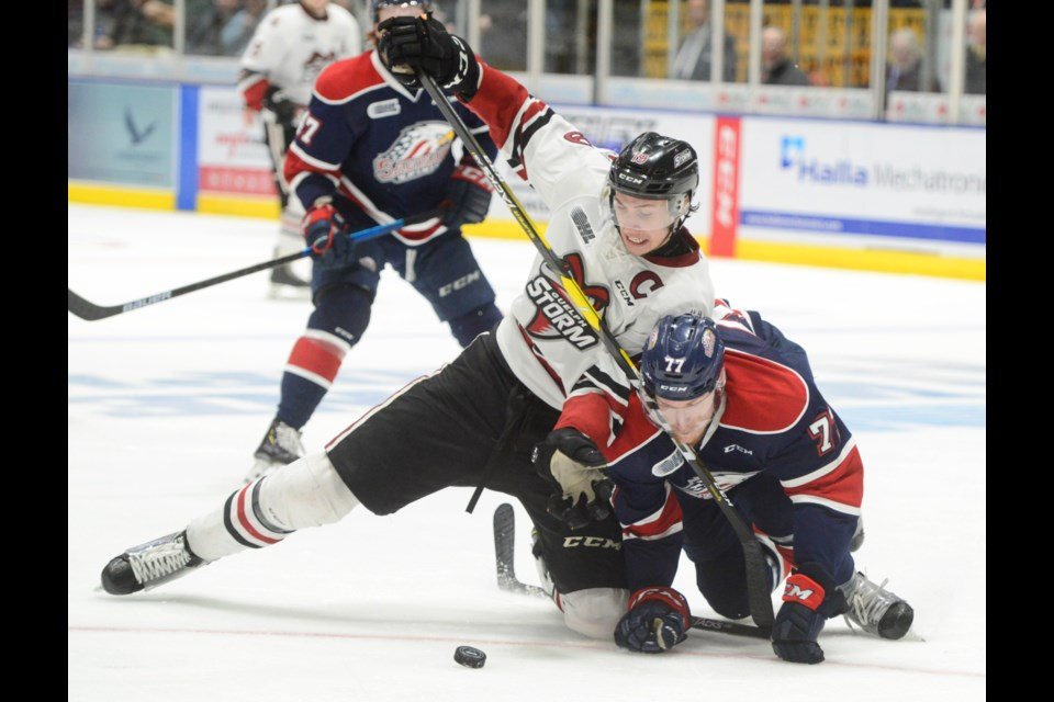The Guelph Storm's Isaac Ratcliffe battles for the puck with Saginaw's Reilly Webb. Tony Saxon/GuelphToday