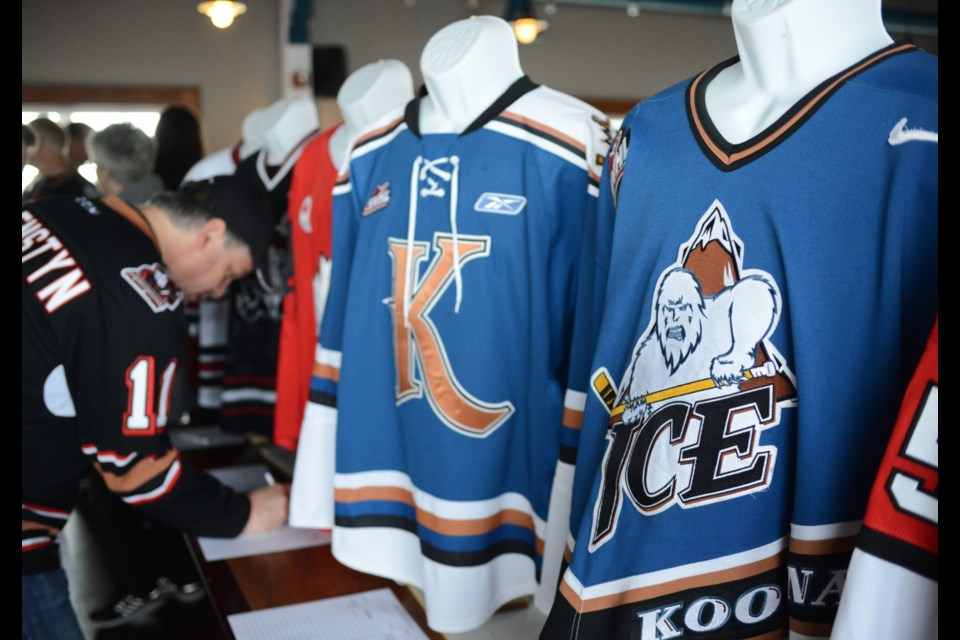 Bidding on some sweet jerseys at the annual Memorial Cup Fan Breakfast Sunday in Halifax. Tony Saxon/GuelphToday