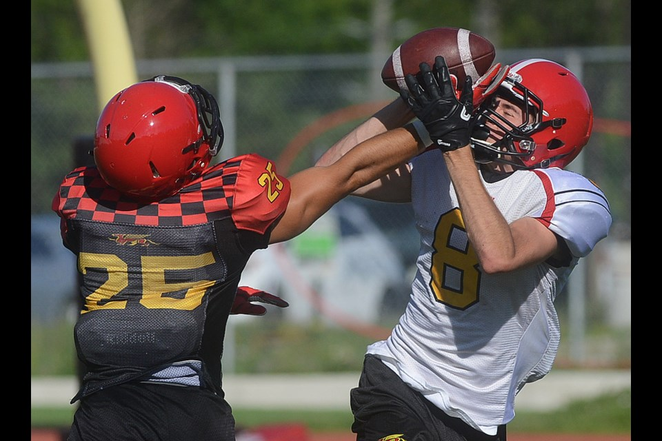 Matthew MacGillivray (8) makes a catch in front of Simon Chaves during the first day of training camp Friday, Aug. 10, 2018, at Alumni Stadium. Tony Saxon/GuelphToday