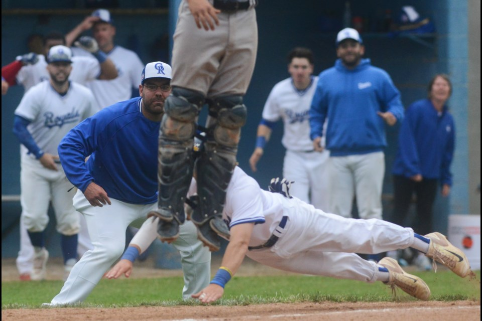 Third base coach Justin Interisano watches intently as Kyle Kush dives into home plate with the winning run Saturday against the Toronto Maple Leafs. Tony Saxon/GuelphToday