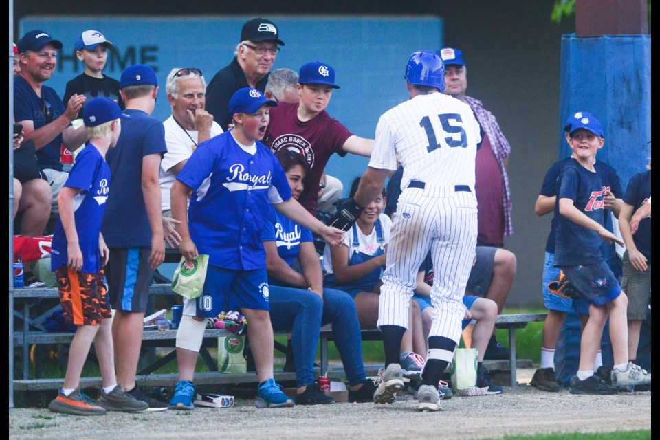 Josh Garton of the Guelph Royals celebrates with some fans after hitting a home run Saturday against the Toronto Maple Leafs at Hastings Stadium. Tony Saxon/GuelphToday