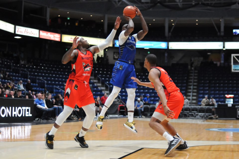 Olu Famutimi, middle, of the Guelph Nighthawks puts a shot up between the Fraser Valley Bandits pair of Jaylen Bland, left, and Grant Shepard during Saturday night's Canadian Elite Basketball League game at the Sleeman Centre. Rob Massey for GuelphToday