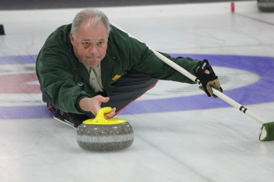 A Guelph Curling Club member delivers his final rock of the end in the 2018 Tarlton bonspiel. Submitted photo