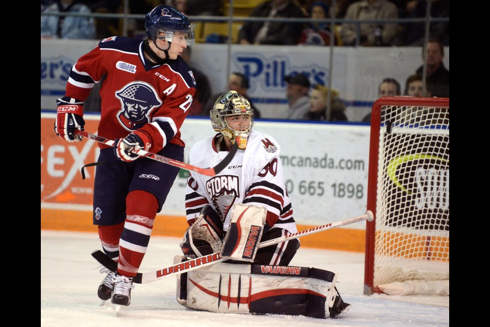 The Kitchener Rangers Darby Llewellyn and Guelph Storm goaltender Michael Giugovaz look back to see the puck go in the net Tuesday, Feb. 22, 2016, in Kitchener. Tony Saxon/GuelphToday
