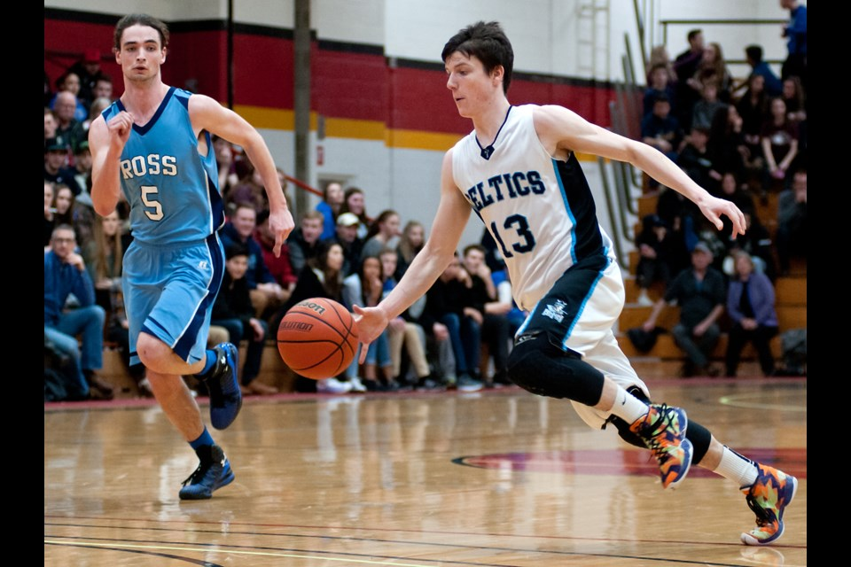Chris Poloniato (13) of the Bishop Macdonell Celtics starts a charge to the basket as Daniel Street (5) of the Ross Royals tries to catch up during the District 10 senior boys' basketball final Saturday night at the Mitchell Athletics Centre. The Celtics won 60-36. Rob Massey for GuelphToday