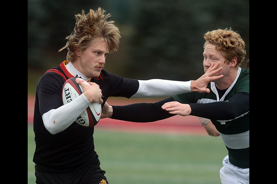 Jordan Hofstra of the Guelph Gryphons fends of a University of Prince Edward Island player at the opening day of the Canadian University Rugby Championships Thursday, Nov. 16, 2017. Tony Saxon/GuelphToday