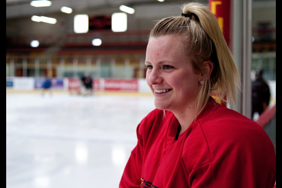 Averi Nooren of the Guelph Gryphons gets a laugh as she watches the defencemen practice during a workout session Wednesday at the Gryphon Centre. Nooren leads the top-ranked Gryphs in scoring with 13 goals and eight assists.