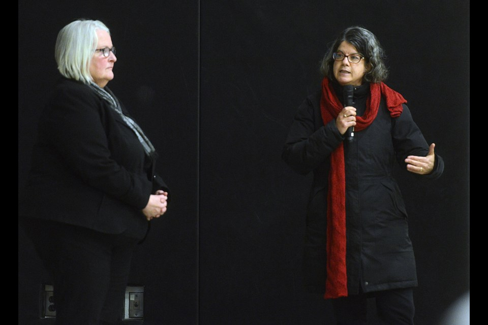 Ward 5 councillor Cathy Downer, left, listens to the Homecoming experience  of a south end resident at a town hall meeting Thursday, Nov. 23, 2017, at St. Michael Catholic School. Tony Saxon/GuelphToday