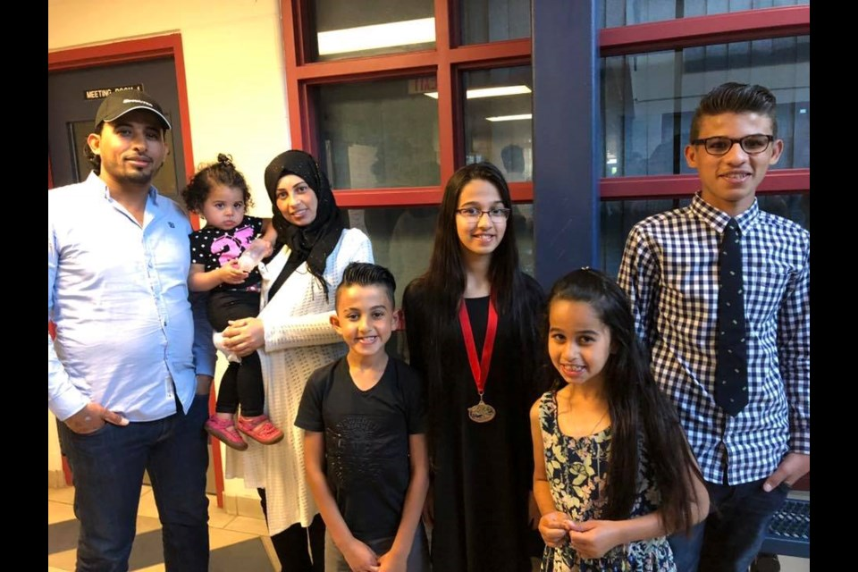 Five of the Barho children and their parents (Photo courtesy of Ummah Masjid And Community Center/Facebook)