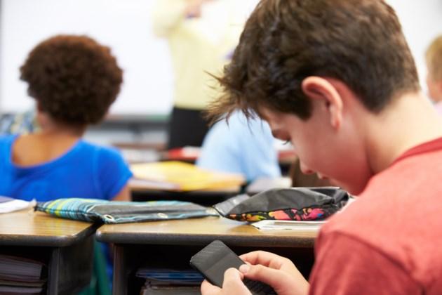 031319-cellphone in classroom-student-smart phone-AdobeStock_52158140
