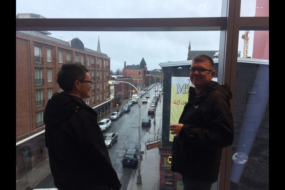 Lori-ann Sacrey and Jeff Sacrey look out over Sackville St. from the ballroom level. (Nicole Bayes-Fleming for HalifaxToday.ca)