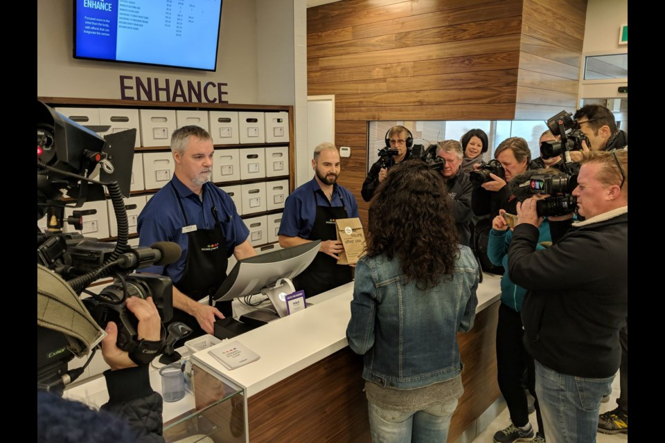 Alicia Wright makes the first cannabis purchase at the Clyde St. store (Mark Hodgins/HalifaxToday.ca)