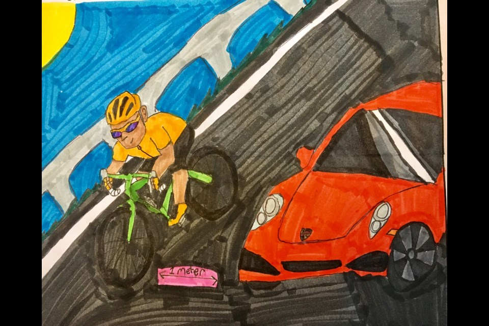 Gabriel Salley from Annapolis East Elementary School demonstrates the One Metre Rule that cars and cyclists must abide by on our roads. (Photo courtesy of RCMP)