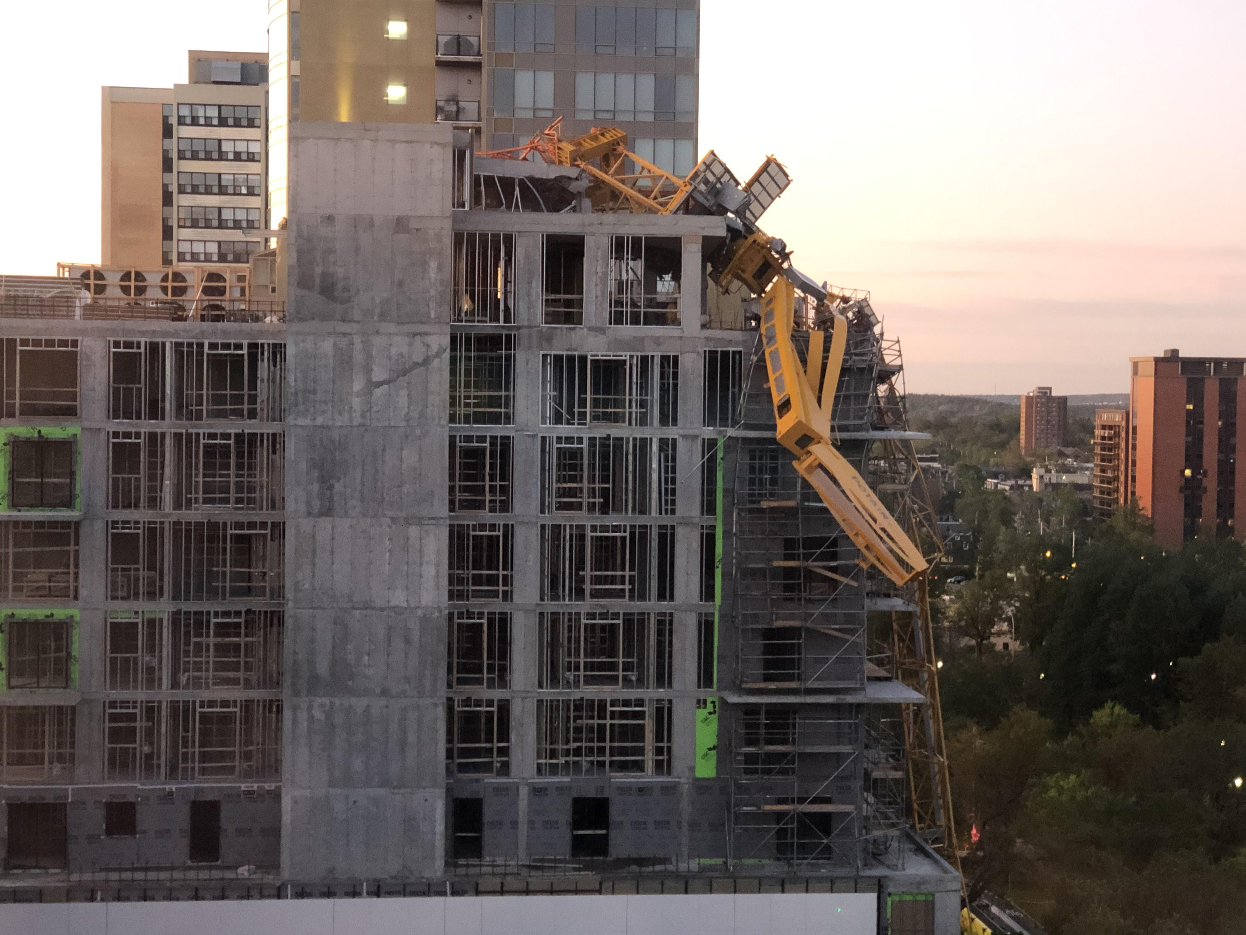 Crane removal could begin Friday as evacuee says expenses piling up