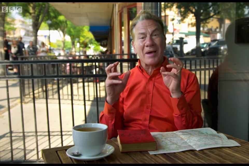 Host Michael Portillo enjoying a coffee downtown. (via BBC 2)