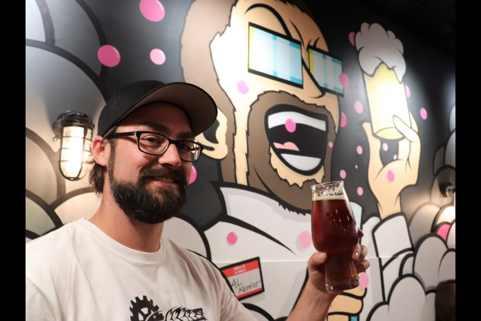 Owner and brewer Al Renner in front of a mural in Alchemy. (via Brendan Kergin)