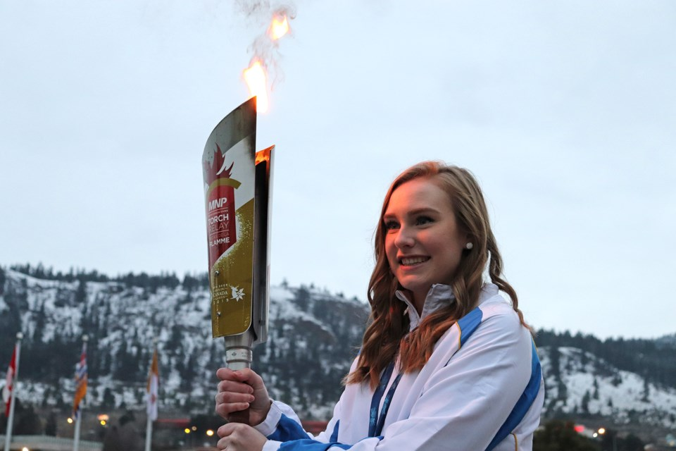 Corryn Brown, the 2011 Canada Games gold medal winner in curling, with the torch at its arrival. (via Brendan Kergin)