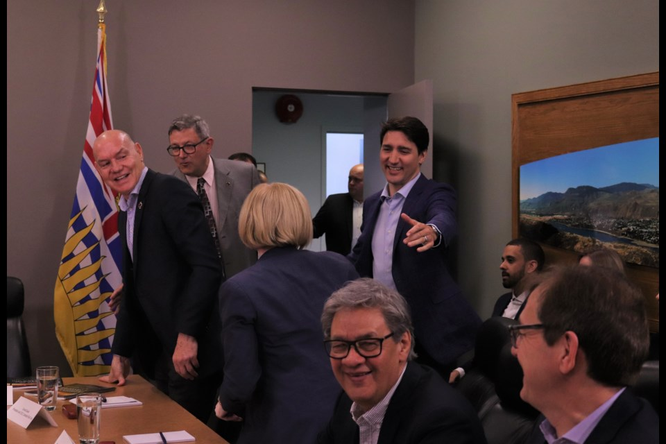 Prime Minister Justin Trudeau (centre right) greets Carla Qualtrough (centre front), Minister of Public Services and Procurement and Accessibility, while Conrad Sauvé (far left), president of the Canadian Red Cross and Kamloops Mayor Ken Christian (left) meet. (via Brendan Kergin)